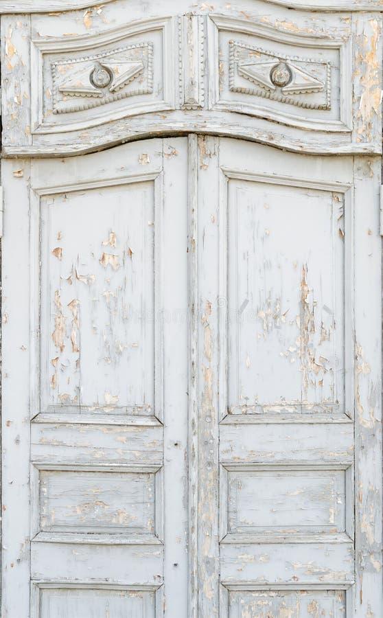 Old vintage door. Old white vintage door with peeling paint stock photos