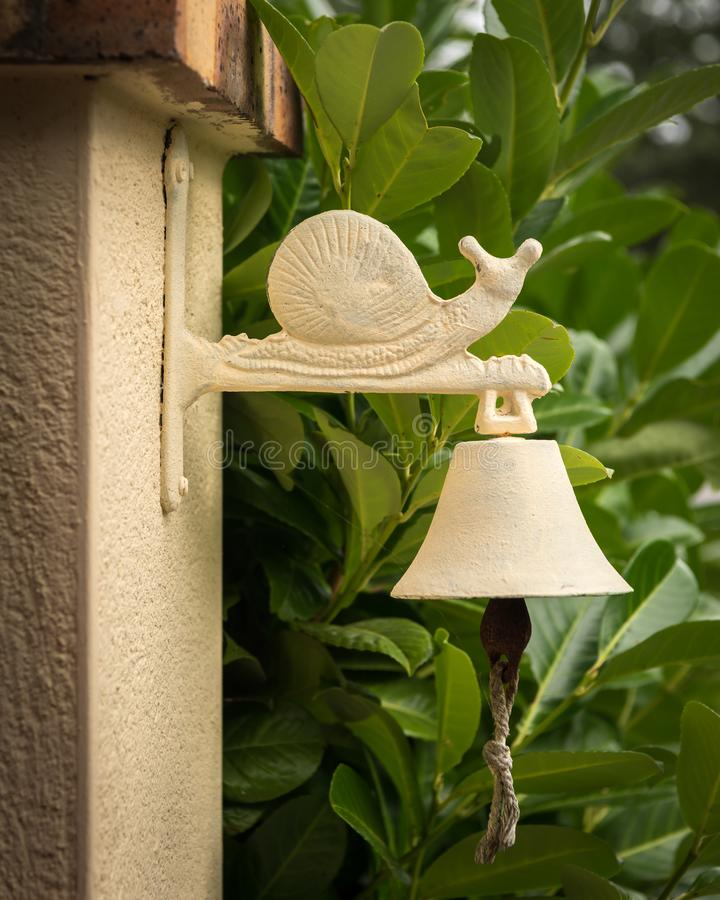 Old vintage doorbell with figure of a snail on top royalty free stock image