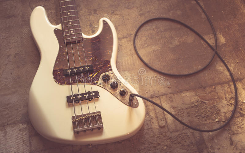 Old vintage electric bass guitar stock photography