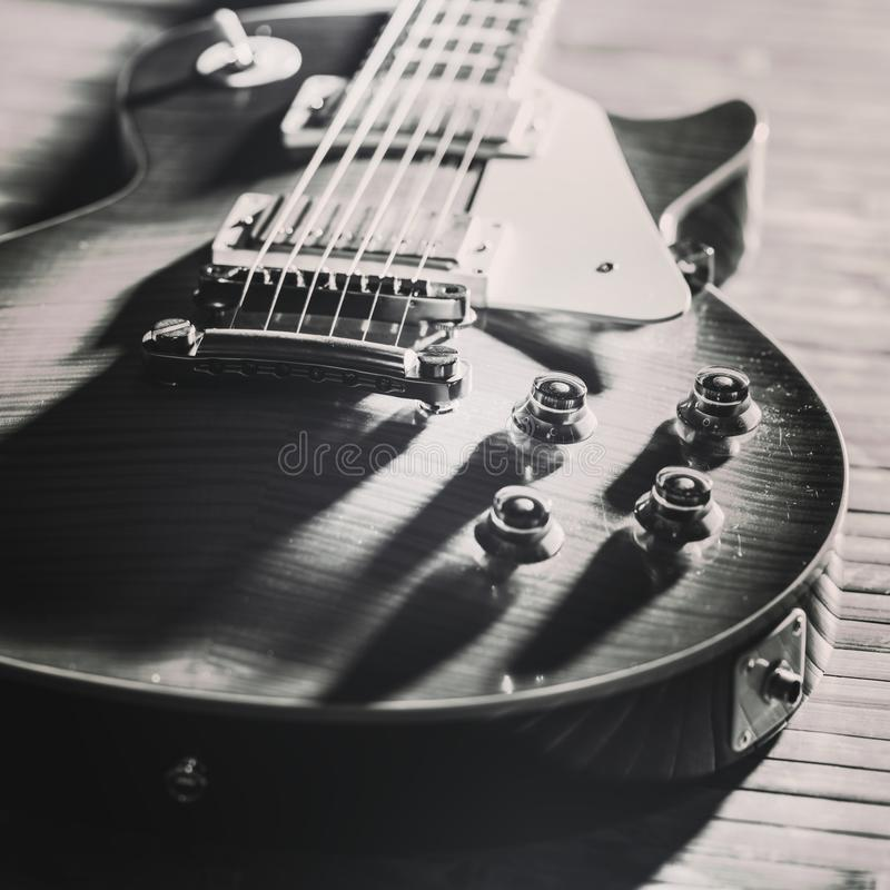 Old Vintage electric guitar body. BW image. Old Vintage electric guitar body close-up view is on the wood floor. BW image stock images