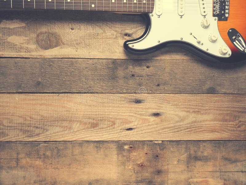 Old vintage guitar on rustic wood royalty free stock photo
