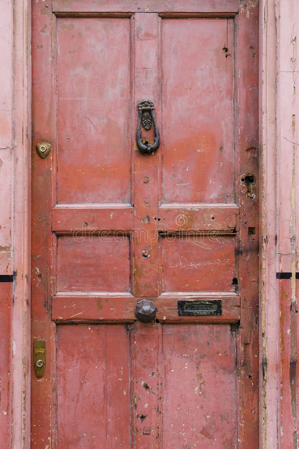 Old vintage english style red salmon pink front door with age re stock image