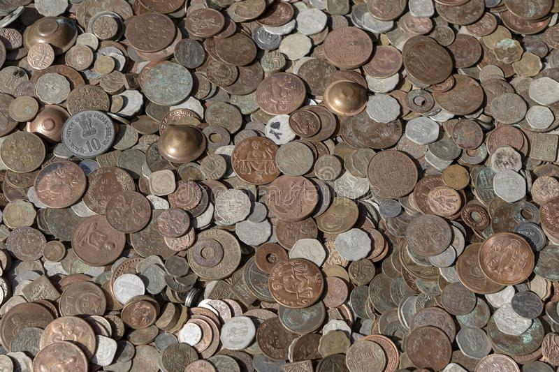 Old vintage fake coins background for sale to tourists in the Indian market on the street in Rishikesh, India. Close up. Top view royalty free stock image