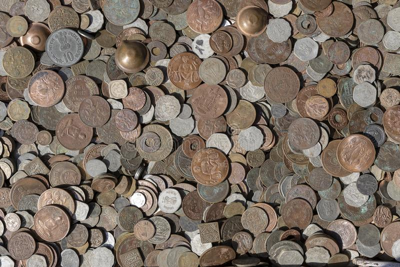 Old vintage fake coins background for sale to tourists in the Indian market on the street in Rishikesh, India. Close up. Top view stock photos