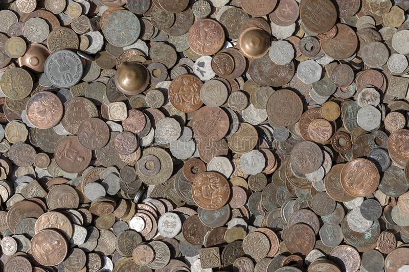 Old vintage fake coins background for sale to tourists in the Indian market on the street in Rishikesh, India. Close up. Top view royalty free stock photos
