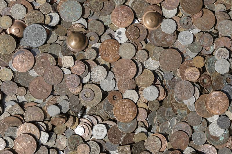 Old vintage fake coins background for sale to tourists in the Indian market on the street in Rishikesh, India. Close up. Top view royalty free stock photo