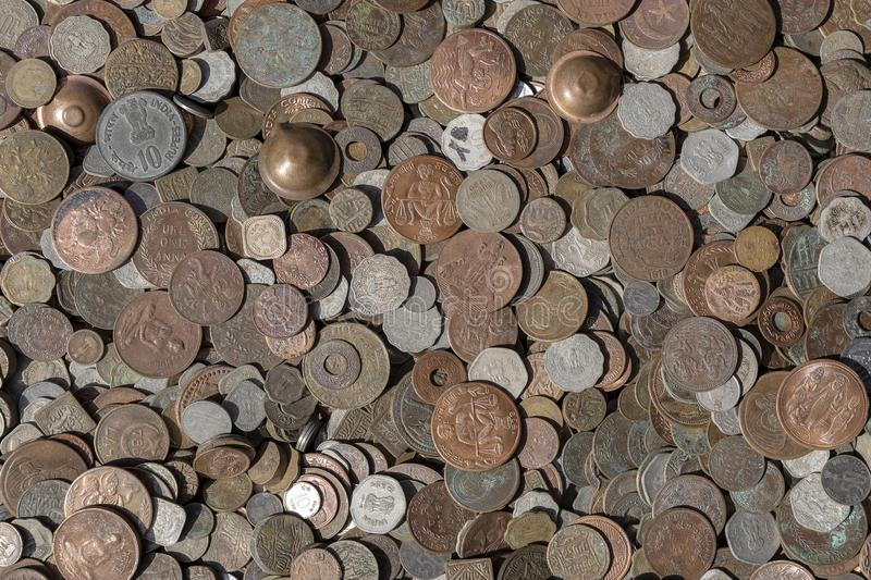 Old vintage fake coins background for sale to tourists in the Indian market on the street in Rishikesh, India. Close up. Top view stock photo