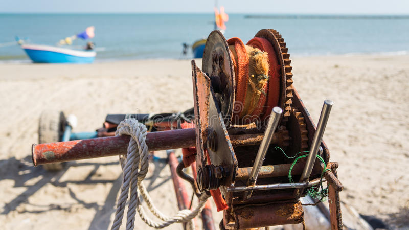 old vintage fishing reel with boat and sea in backgoround stock photos