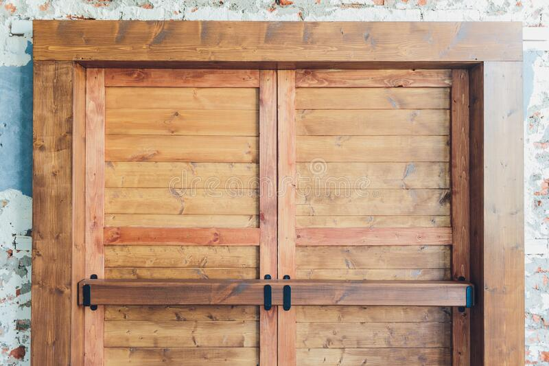 Old vintage folding wooden door frame with brass handle in countryside. Old vintage folding wooden door frame with brass handle in countryside stock images