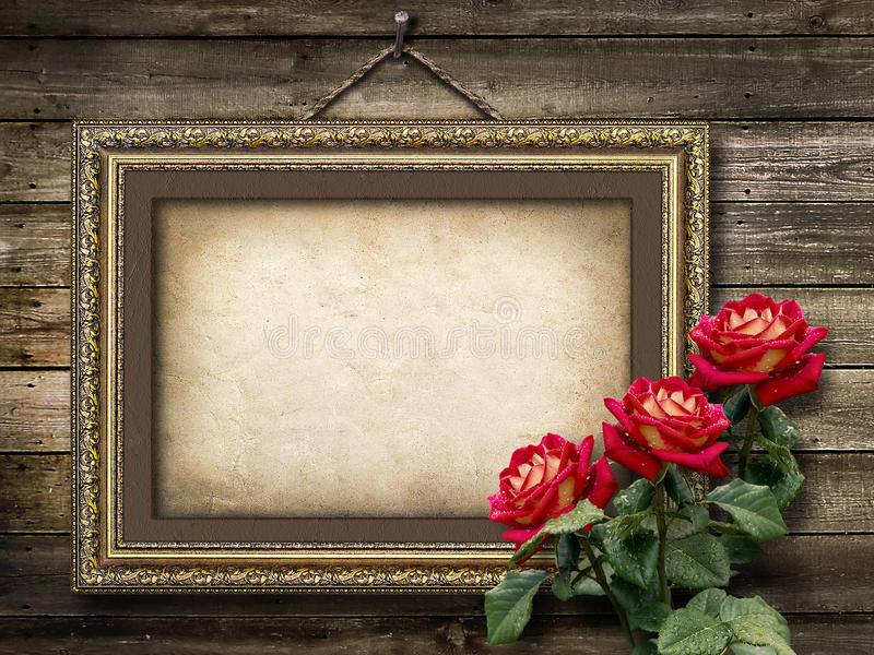 Old vintage frame for photos and a bouquet of red roses stock photos