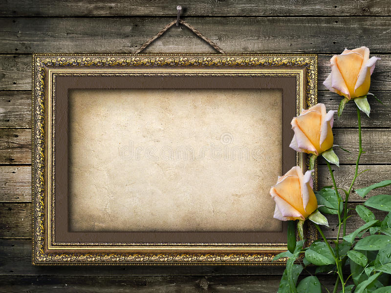 Old vintage frame for photos and a bouquet of yellow roses royalty free stock photos