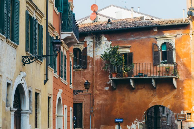Old vintage green windows and balconies in Verona. Old vintage green window and balconies, golden mood, old city of Verona stock photography