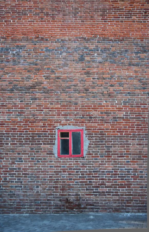 Old vintage grunge brick wall and small window stock photography