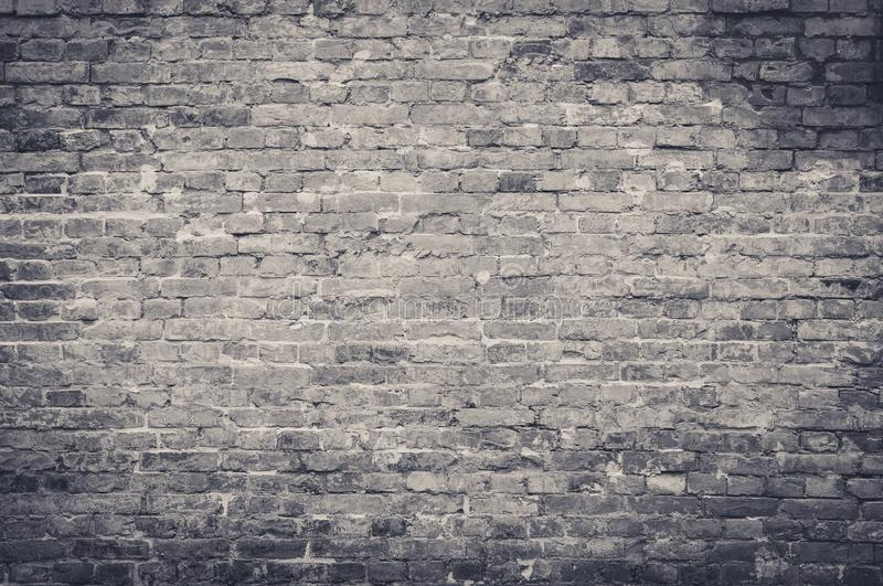 Old vintage and grunge red brick wall background texture with scratches and cracks in black and white color, greyscale tone royalty free stock image