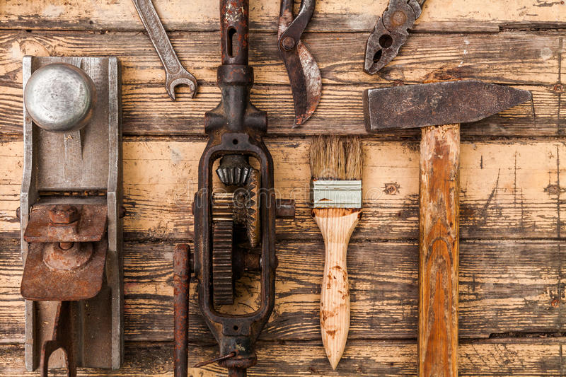 Old vintage hand tools on wooden background.  royalty free stock photo