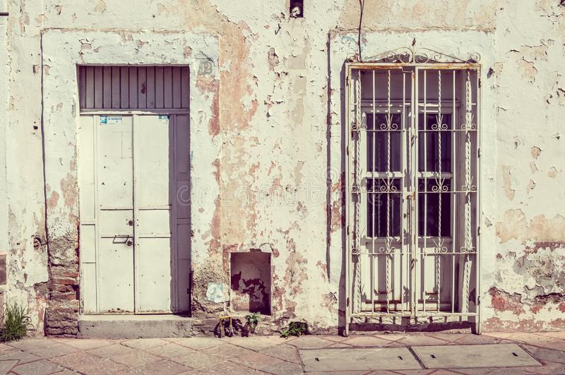 Old vintage House Exterior and Front Door Seen on a Mexico Street on white light color stock images