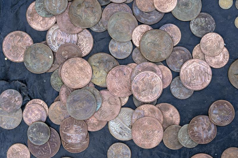 Old, vintage indian coins background in Indian market on the street in Rishikesh, India. Close up royalty free stock photo