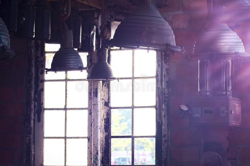 Old vintage Industrial interior with bright light coming through windows. Beautiful sunlight stock photography