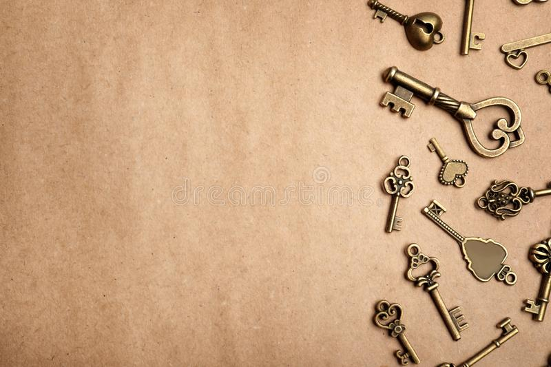 Old vintage keys on craft paper, flat lay. Space for text royalty free stock photo
