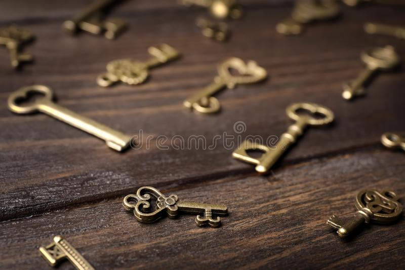 Old vintage keys on wooden background. Closeup royalty free stock images