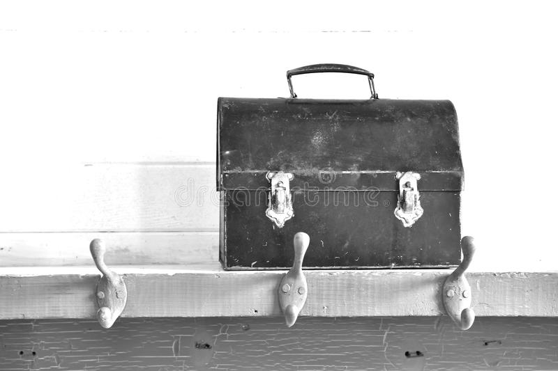 Old Vintage Lunch Pail. A black and white image of an old vintage lunch pail on a wooden shelf stock images