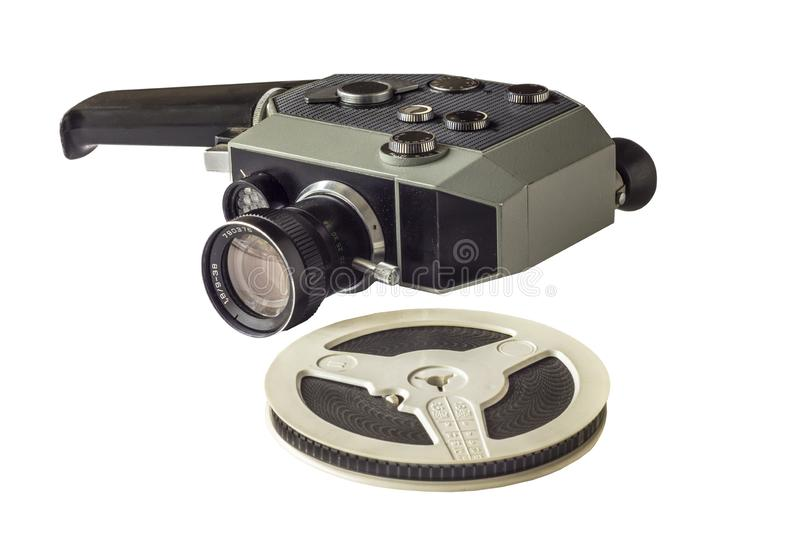 Old vintage mechanical film camera super 8 mm with bobbin close-up isolated on white background stock photo
