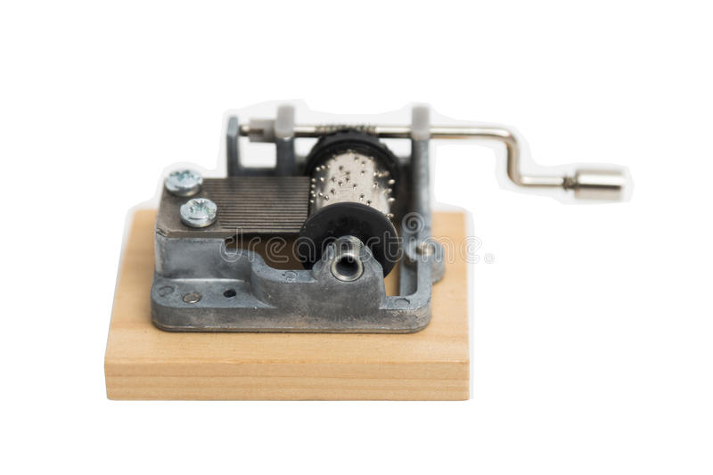 Old vintage metal small barrel organ on wooden stand on isolated background. stock photo