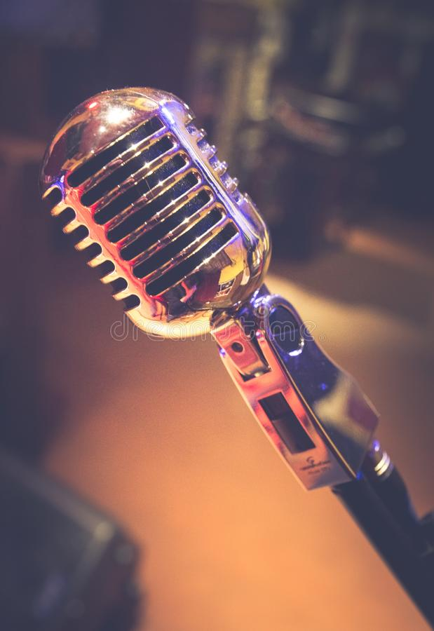 Old vintage microphone since 1950. Old vintage 1950 style microphone, used for live music events royalty free stock photos