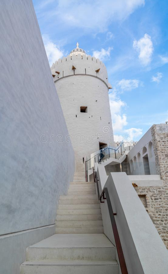 Old vintage Middle Eastern building and tower against the blue sky and clouds - Qasr Al Hosn in Abu Dhabi city stock photo