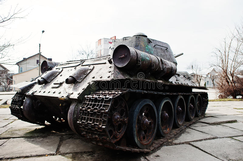 Old vintage military tank in the city pedestal. royalty free stock image