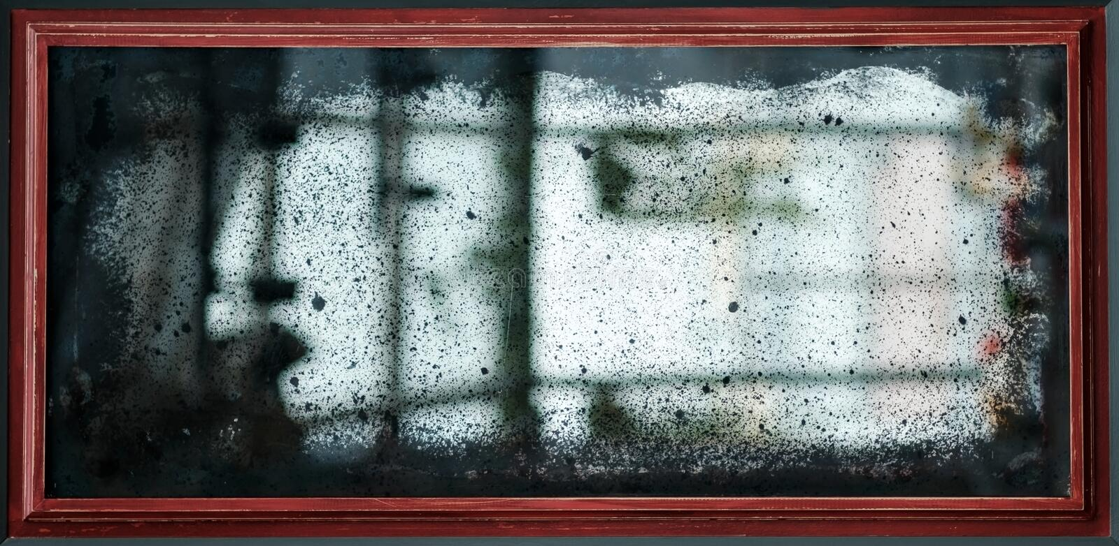Old vintage mirror with scratches and dust. stock image