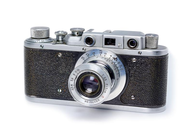 Old vintage 35mm film photo camera isolated on white background. stock image