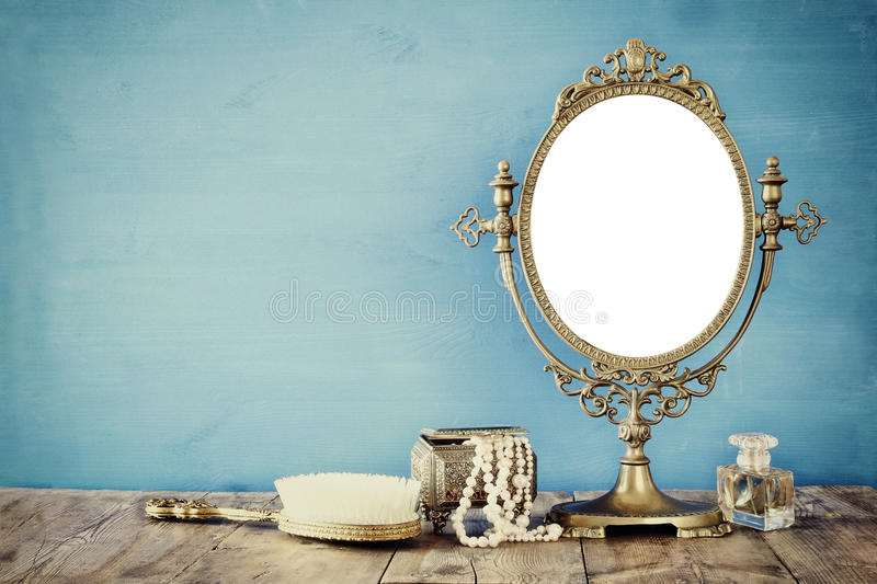 Old vintage oval mirror and woman toilet fashion objects stock photos