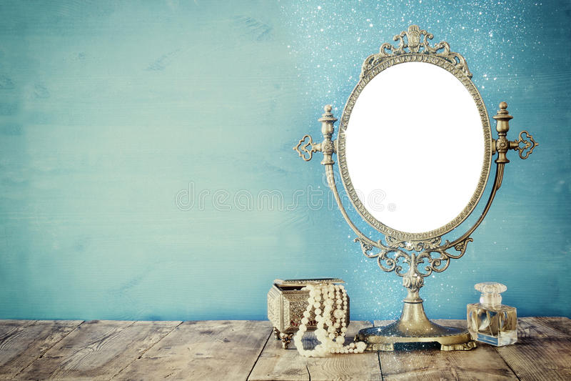 Old vintage oval mirror and woman toilet fashion objects stock image