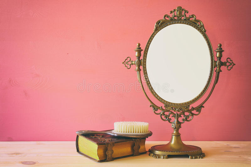 Old vintage oval mirror and woman toilet table royalty free stock photo