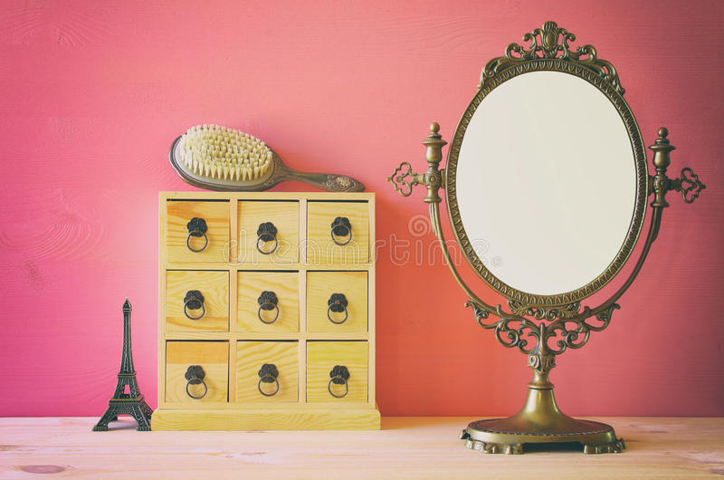 Old vintage oval mirror and woman toilet table royalty free stock photos
