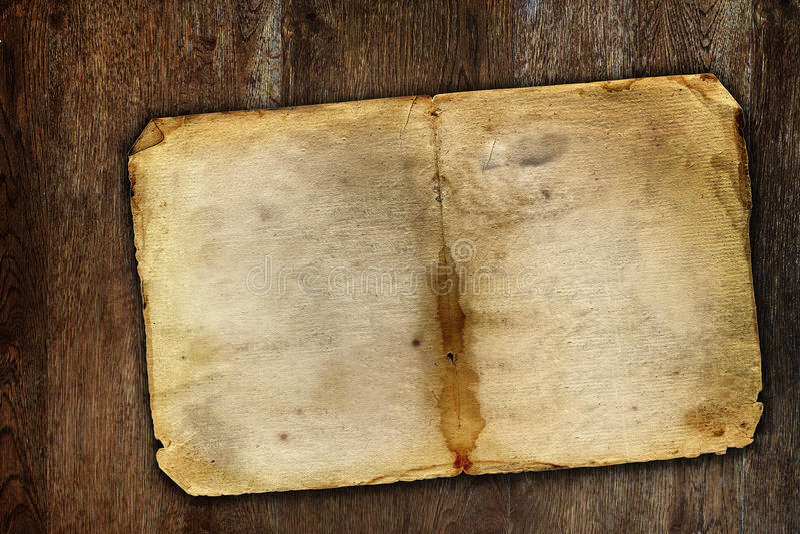 Old vintage paper on brown wooden surface