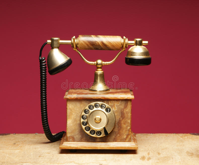 An old and vintage phone on a red background royalty free stock photo