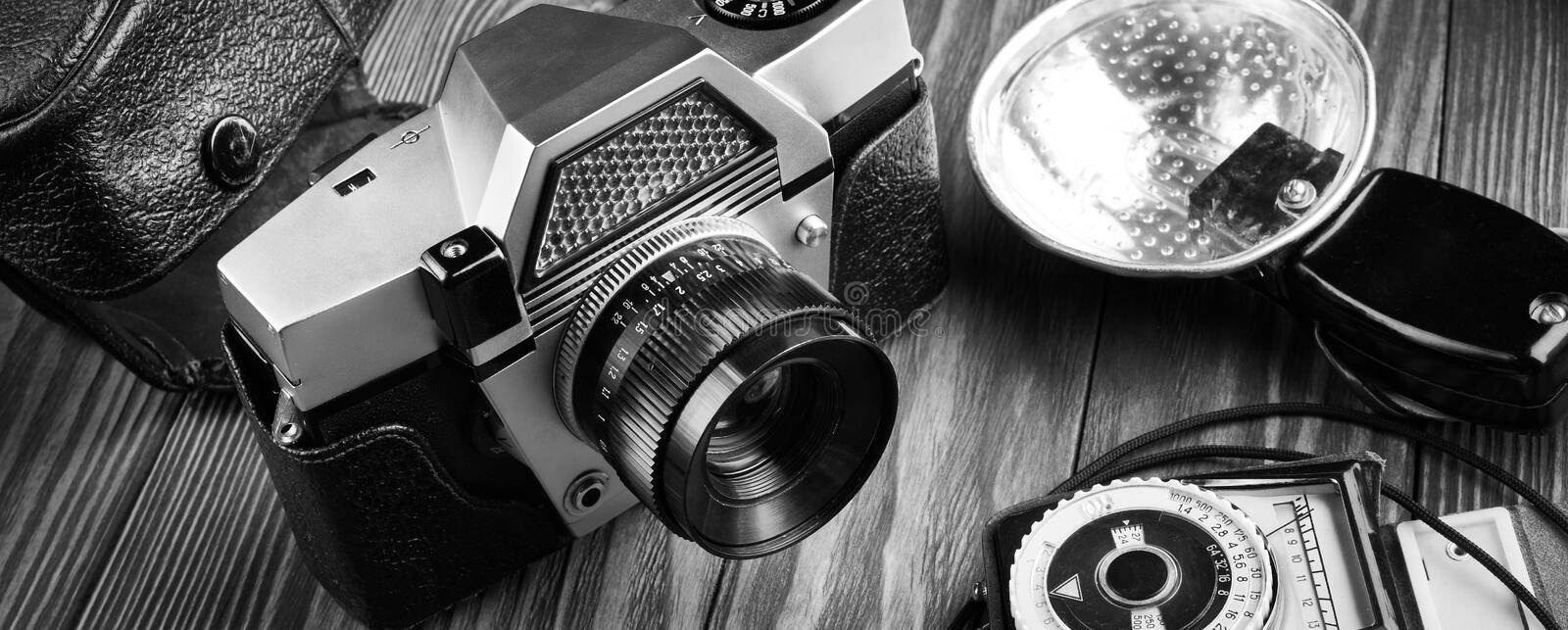 Old vintage photo camera, flash and exposure meter stock photography