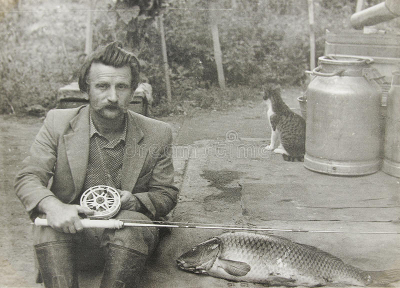 Old vintage photo man with a fishing rod royalty free stock image