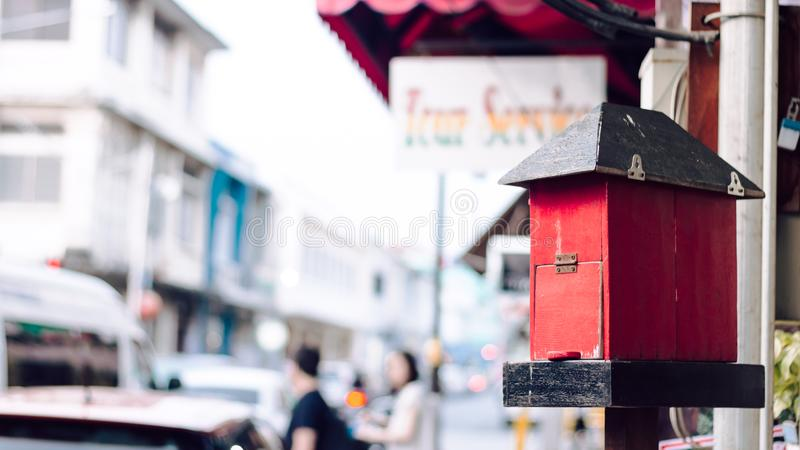 Old vintage postbox over blurred street background. Classic red wooden mailbox at the Phuket old town, Thailand. Retro style conce stock image