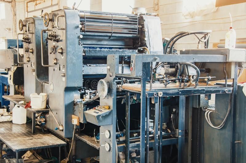 Old vintage printing machine in the print shop. Magazine, newspaper, brochure, paint. Old vintage printing machine in print shop. Magazine, newspaper, brochure royalty free stock photography