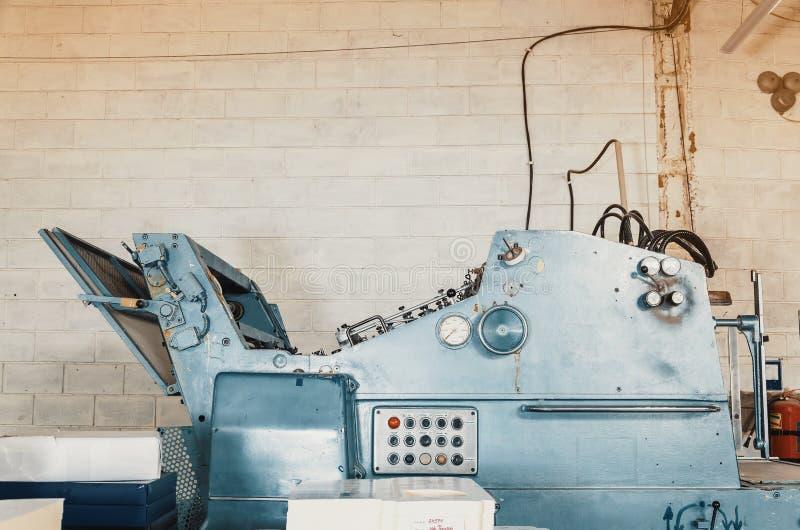 Old vintage printing machine in the print shop. Magazine, newspaper, brochure, paint. Old vintage printing machine in print shop. Magazine, newspaper, brochure stock images
