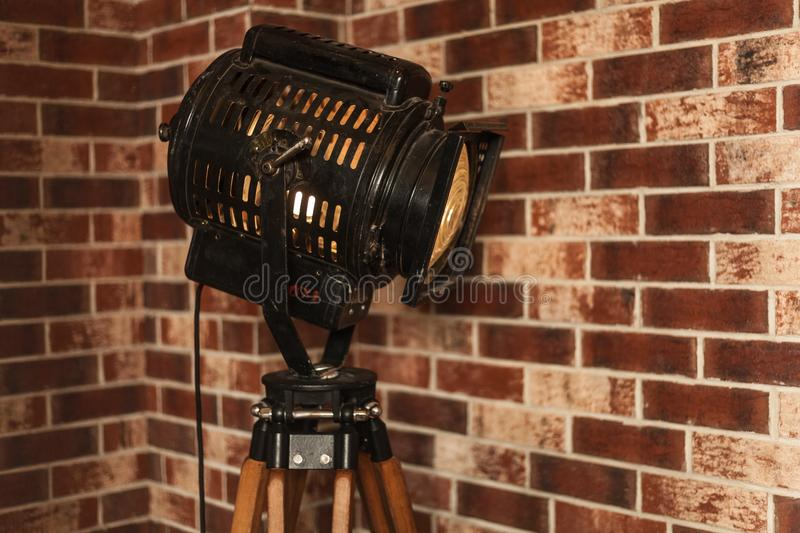 Old vintage projector indoor interior with brick wall. Loft style royalty free stock photo