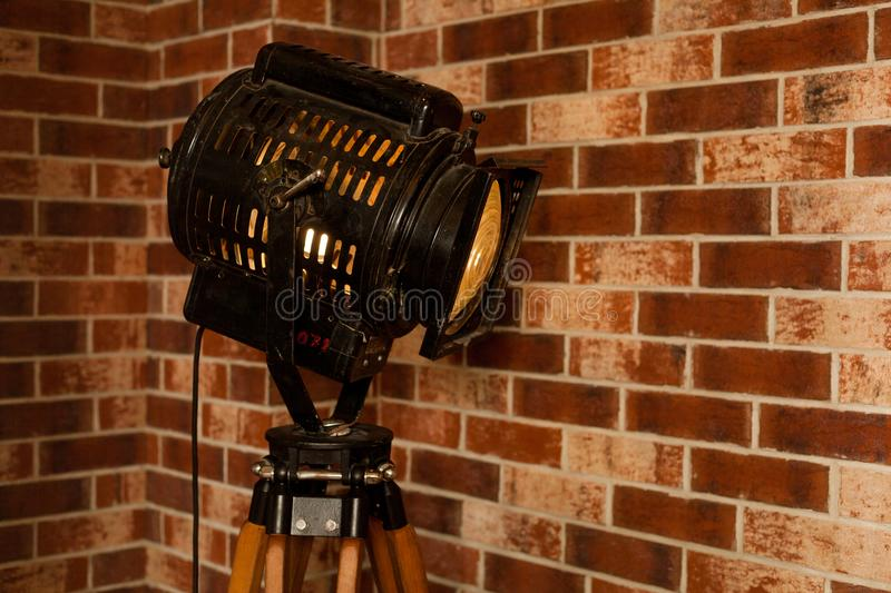 Old vintage projector indoor interior with brick wall. Loft style royalty free stock image