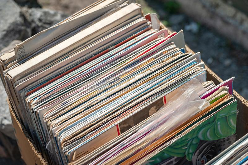 Old vintage records folded in a box stock photo