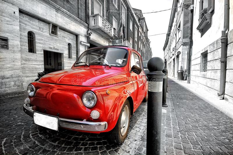 Old vintage red black and white classic parked fiat 500 car in italy rome postcard stock image