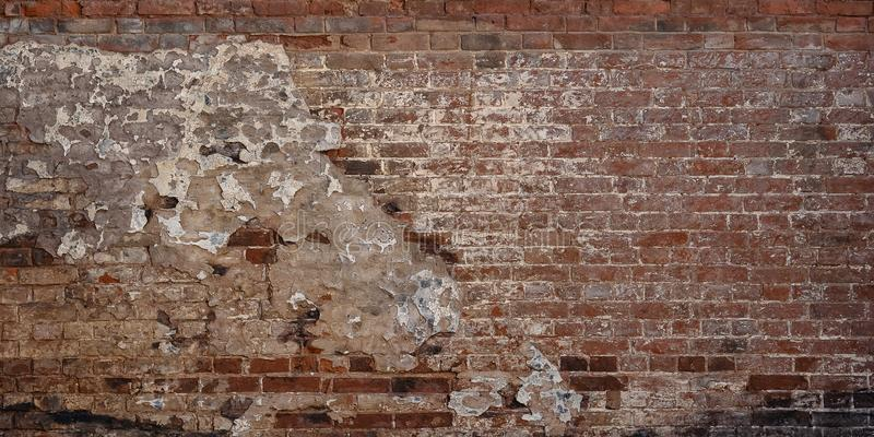 Old Vintage Red Brick Wall With Crashed White Plaster Texture Background royalty free stock photo