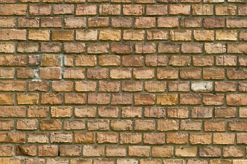 Old vintage red brick wall fragment background texture. Close up stock images