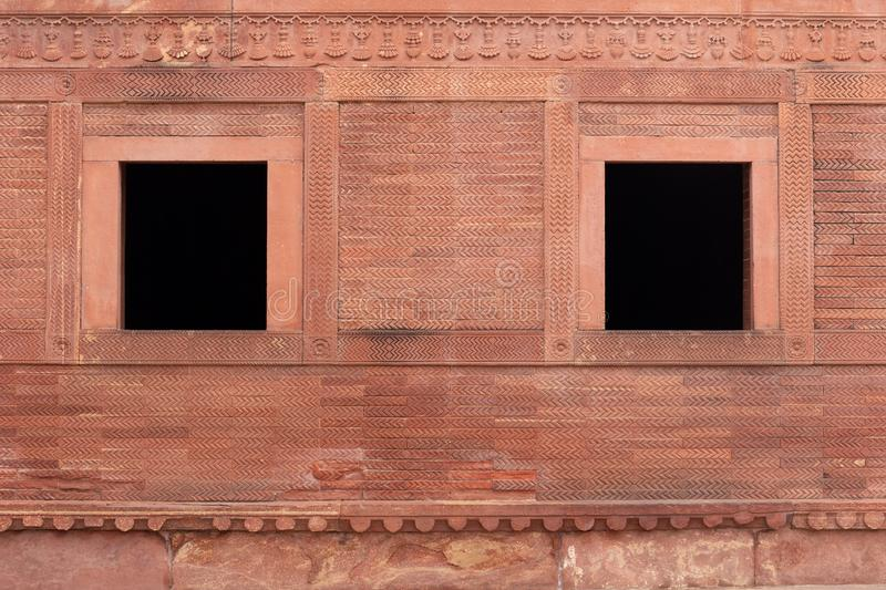 Old vintage red brick wall and two windows at Fatehpur Sikri Pal. Ace royalty free stock photography